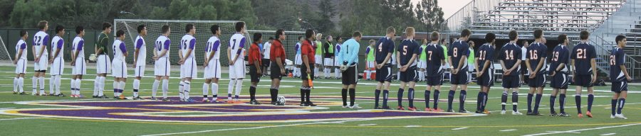 Standing proud: Kingsmen soccer players prepare for a game.