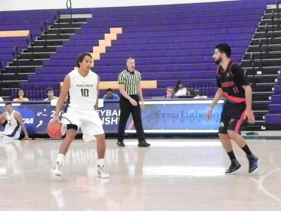 Battle tested: Michael Palmer dribbles up the court against Afghanistan.   Photos by Katelyn Downing - Staff Photographer