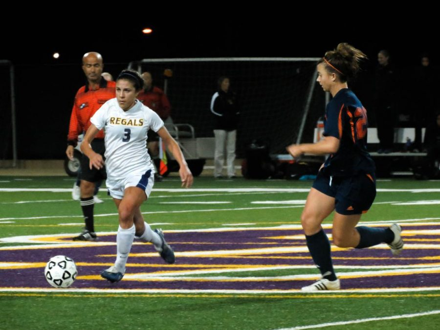 Close encounters: Lindsay Armenta dribbles the ball and below, Kristina Hulse jockeys for position.  Photo by Melina Esparza - Photo Editor