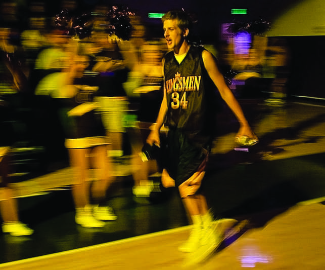 Getting the party started: Collin Knudsen runs onto the court during last year's March Madness.   File photo