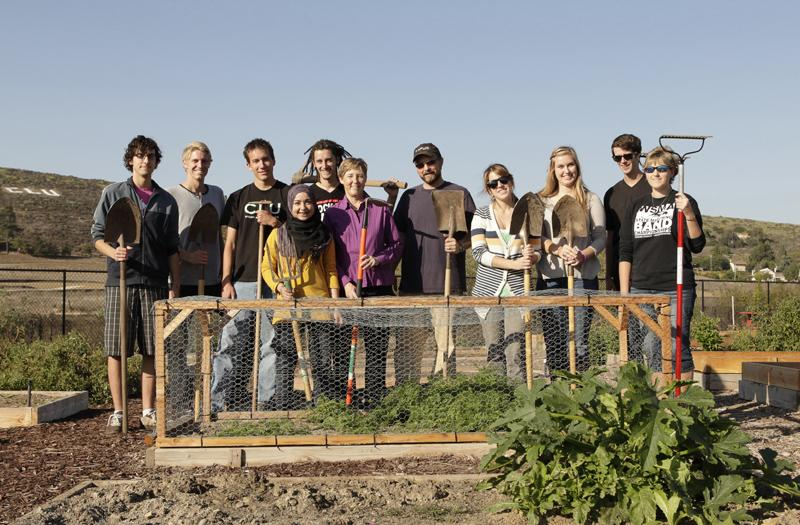 A day in the garden: Samuel Thomas and students work in the CLU garden as part of the SEEd Project at CLU, which works on sustainable ways to grow and buy local produce. Photo by Brian Stethem - University Photographer