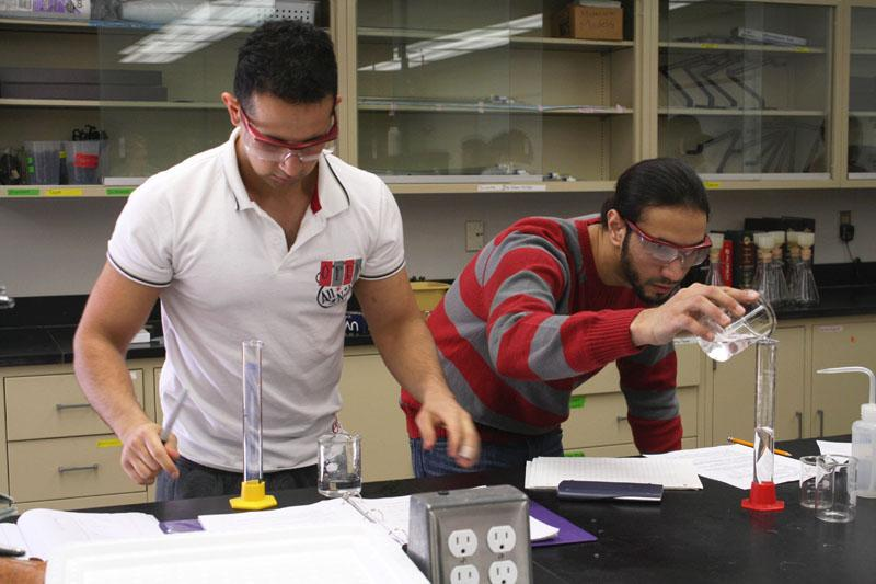 Recipe for success: Above, students Hamza Mujaddidi (left) and Ahmad Jaffar work on their lab experiment in General Chemistry II. Below, Holly Webb synthesizes salicylic acid in chemistry lab.  Photo by Tora Thuland - Staff Photographer