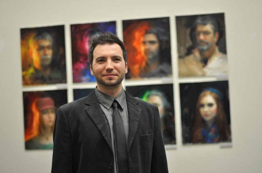 An artist with his work: Ignatov with some of his paintings in the Kwan Fong Gallery.