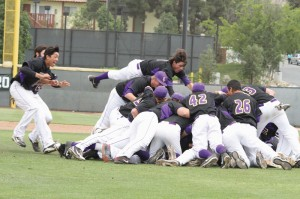 Nothing sweeter: Ramsey Abushahla (left) and Mike Vinyard (airborne center) jump onto the dog pile of teammates as they celebrate their championship victory over Pomona-Pitzer on Sunday afternoon. This is the Kingsmen's first SCIAC title since 2001. Photo courtesy of Tracy Maple - CLU Sports Photographer