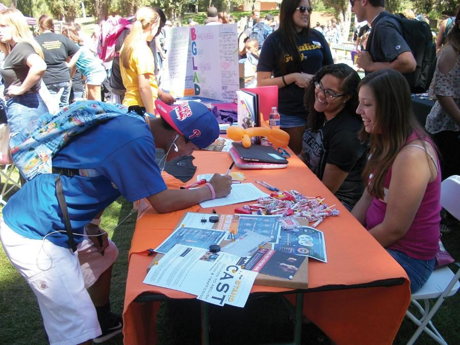 Clubs on parade: Freshman Ryan Murata signs up for Not For Sale, which works to fight human trafficking. Photo by Rebecca Bomfin- Staff Photographer