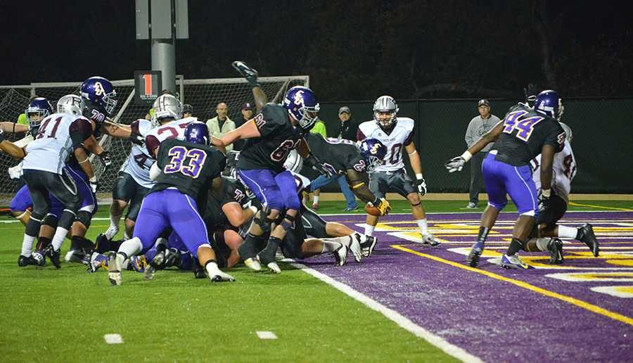 Leap of Faith: Wayne Chapman leaped over the pile for the Kingsmen's lone touchdown of the ballgame. Chapman finished the game with 57 yards rushing on 17 attempts. He also recorded 2 receptions for 21 yards.  Photo by Arianna Cook - Staff Photographer