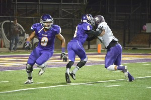 Running away with it: Chris Cabrera celebrated his senior night with four tackles and one interception. Photos by Arianna Cook - Staff Photographer