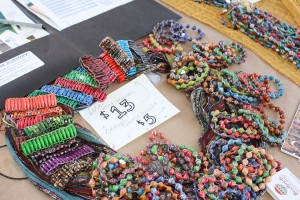 BeadForLife: Junior Berlin Galvan will sell beaded bracelets made by Ugandan women at the World Trade Fair on Nov. 14.   Photo by  Stine Norum- Staff Photographer