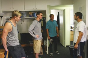 The perks of showing your wallflowers: Freshmen Jacob Derksen, Luke Johnson and Armaan Meshkati let a prospective student tour their room.  These Pederson residents will each receive an iPad at the end of the year.   Photo by  Melina Esparza - Photo Editor