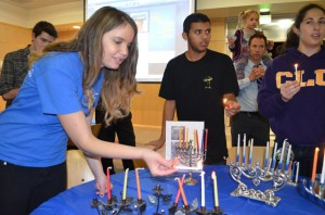 Hanukkah celebrations: Senior Allison Himber lights the menorah at one of the holiday celebrations happening on campus.  Photo by Arianna Cook-  Staff Photographer