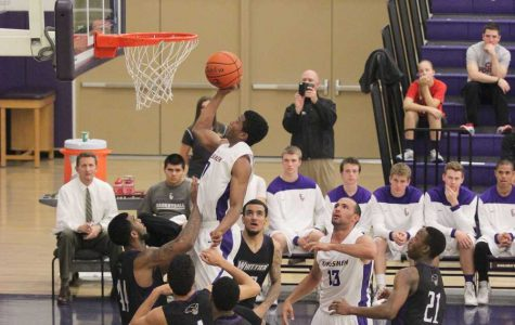 Living above the rim: Arik Smith makes a contested layup on Feb. 19 against Whittier. Smith led the team with 19 points in the 68-56 victory. Photo by Courtney Nunez - Staff Photographer