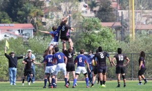 All hands on deck: Sophomore Aaron Bowman is lifted by his teammates during a line out during the Feb. 22 match against Pepperdine University.  Photo by Isabella Del Mese - Staff Photographer