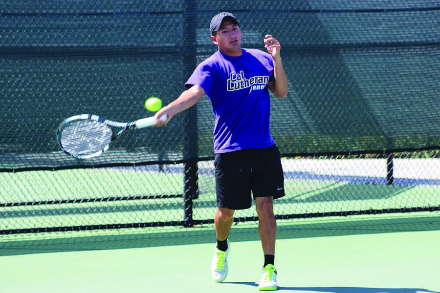 Straight dominance: Moises Cardenas won both his singles (7-5, 3-6, 6-3) and doubles match (8-2 with partner Fergus Scott) on April 5 at Poulson Tennis Courts.  Photo by Isabella Del Mese - Staff Photographer