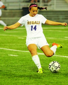 Through Ball: Freshman midfielder Charlotte Rosen looks to pass the ball to a teammate in the Regals' Sept. 24 win against Redlands. Photo by Andrea Whisler- Staff Photographer