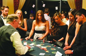 Blackjack: Cal Lutheran students test their luck at the table at North Ranch Country Club, Friday, Oct. 18. Photo by Rikke Bovre - News Editor