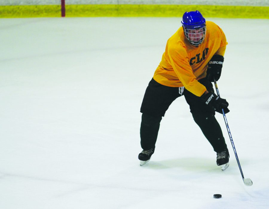 Grinder: Spencer Votipka working on his puck handling at the Knights' practice at the Simi Valley Iceoplex.  Photo by Genesis Rodriguez - Staff Photographer