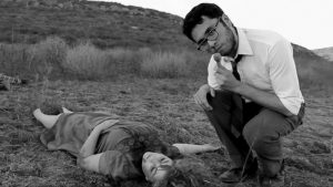 Dead or alive: TV reporter Bill Bardough (Mario Gonzales) leans in for a closeup over a dead zombie (Christine Dauzat) in 'Night of the Living Dead' playing October 23-26 in the Black Box Theatre. Photo courtesy of  Kenneth Gardner