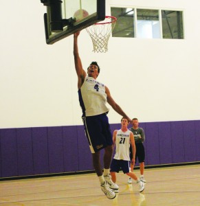 Junior forward Guy Lynott goes up for a dunk during practice. Photos by Paulyn Baens - Staff Photographer
