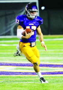 Setting the record straight: Junior quarterback Nick Isham rushing the ball outside of the pocket. Isham threw for a CLU record-tying six touchdowns along with 417 yards. Photo by Andrea Whisler - Staff Photographer
