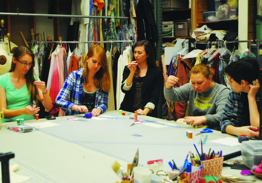 Costume design: Noelle Raffy (left) helping students Dani Kuss and Nikki Page learn how to properly thread a needle for the upcoming semester.