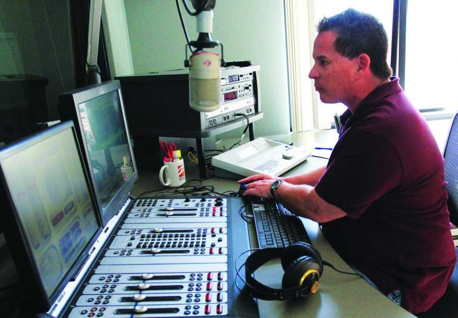 On the air: Lance Orozco, the news director at KCLU, edits together his voice and other audio clips for his news stories that will play during afternoon drivetime.