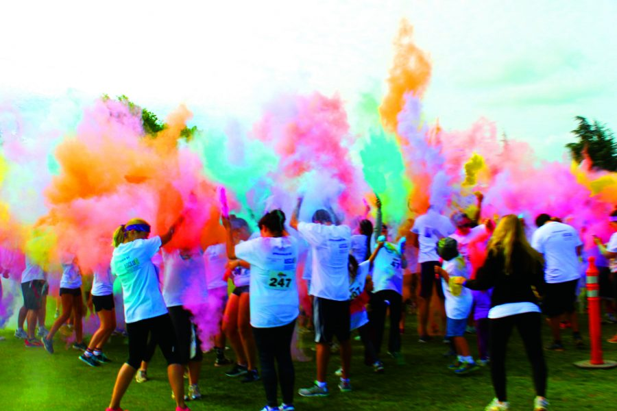 Flying colors: Participants of the 5K Color Dash threw paint in the air creating a cloud of colors.