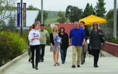Show me around: A tour full of parents of prospective honor students made their way through campus with Presidential Host Karly Loberg.