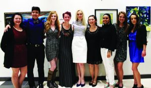 The nine seniors who showcased their artwork in the show 'Ruminations' at William Rolland Art Gallery on April 25.