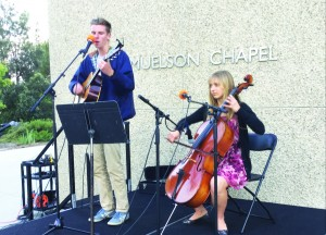 Students Caleb Arndt and Lauren Hesterman were one of the student musician groups to play at the event Faith Matters while event attendees ordered their food and participated in interfaith dialogue.