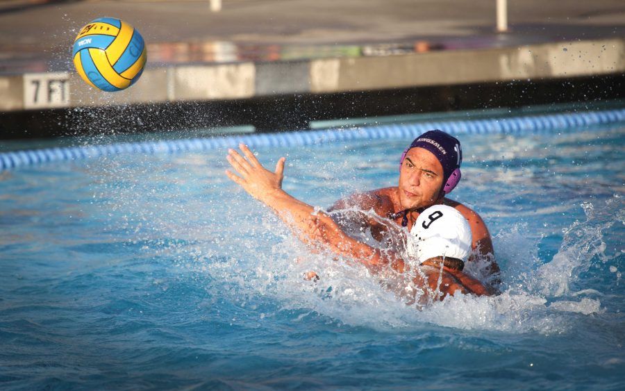 Sophomore Ryan Moguel goes in for the shot against the Cerritos College defense.  Photo by PK Duncan - Staff Photographer