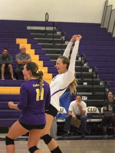 Volleyball captain Allie Eason cheers after a set win with co-captain Nikki Tetherow.