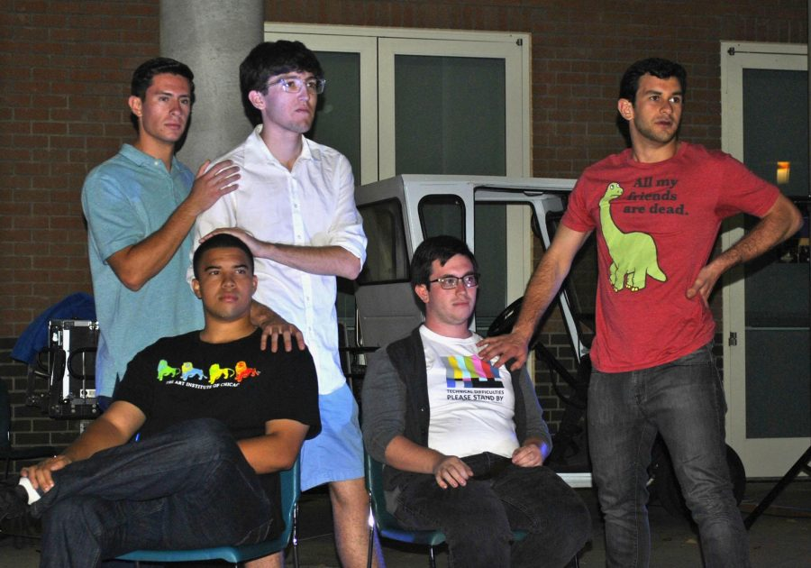 Seasoned improviser, Eric Carthen with newcomers Matt Waxman, Grant Escandon, Ryder Christ, and Frankie Manes. The improv troupe rehearsed outside of Overton hall for their outdoor performance, or what they called
