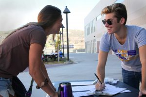 Junior Adam Santa Cruz registers Senior Liz Lawrence for service day at Cal Lutheran. Photo by PK Duncan - Staff Photographer