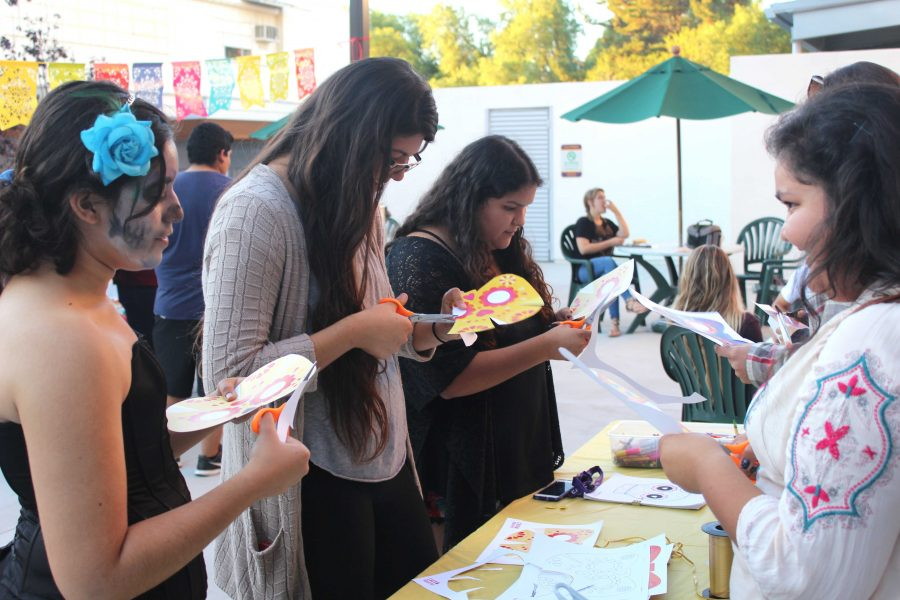 Cal Lutheran students make festive masks as they participate in the Dia de Los Muertos event hosted by the Latin American Student Organization. (Photo from 2015)