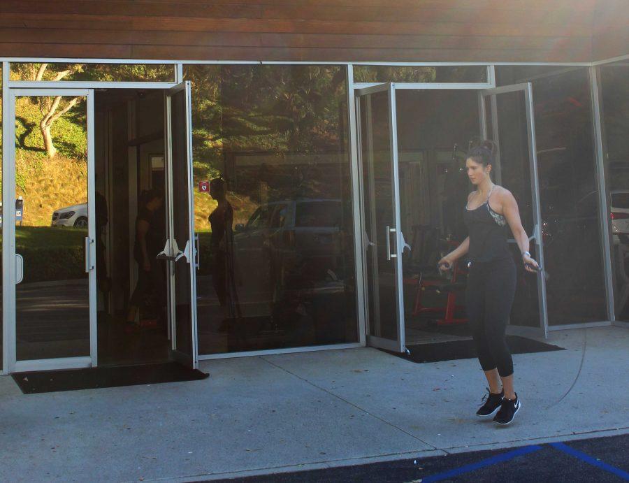 Gym member Megan Harrell moves her workout practice outside.