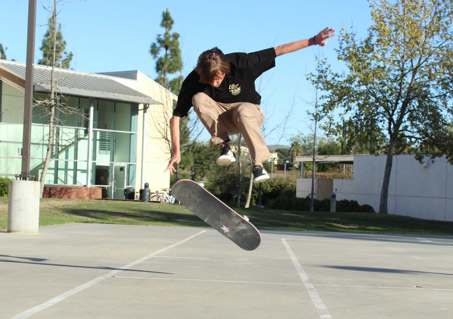 Junior Jani Ertle skates around the Grace basketball courts. Photo by Jackie Rodriguez - Staff Photographer  Click here to check out an Echo Exclusive video on skate culture at CLU by multimedia journalist Brady Mickelson.