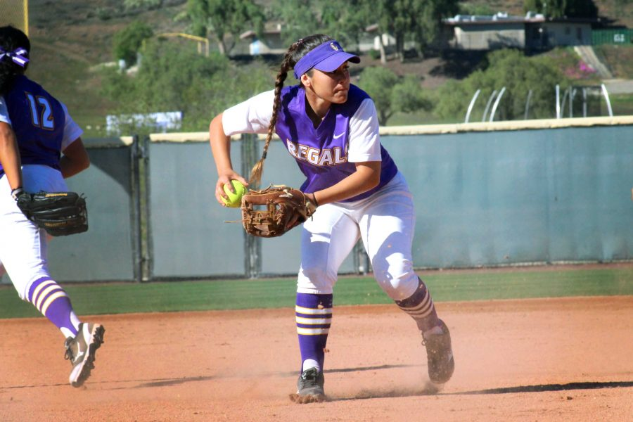 Junior and infielder, Monique Ramirez throws the ball to a fellow teammate during a game against Claremont-Mudd Scripps College. Photo by Kamehana Lee - Staff Photographer