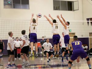 Junior right side hitter Robert Rutecki, junior middle blocker Michael Campbell, and junior setter Keaton Arutian go up for a block against Moorpark.  Photo by Jackie Rodriguez - Staff Photographer