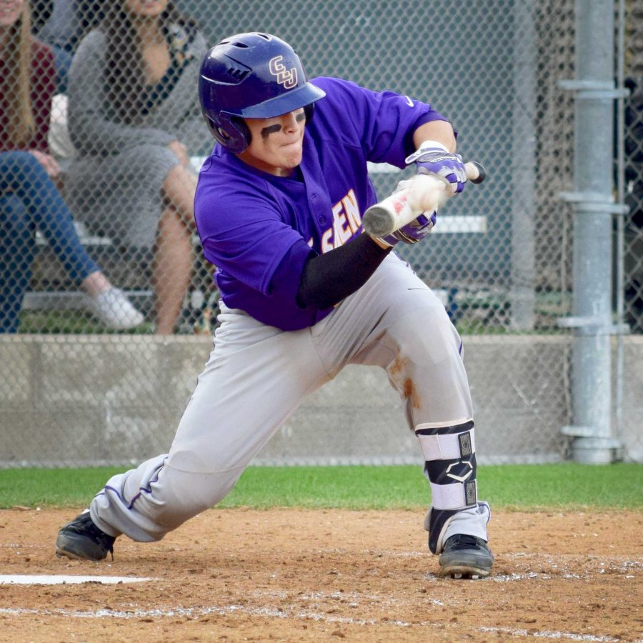 Junior catcher, Eddie Villegas, lays down a bunt moving runners up as well as making it safely to first base. Villegas had two hits against the California Institute of Technology Beavers.  Photo by Roman Valenzuela - Staff Photographer