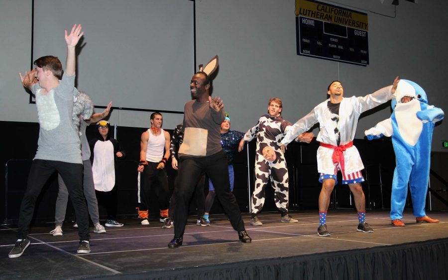 """The 10 participants of Mr. Kingsmen began the show with a choreographed dance to the Lions King's """"Just Can't Wait to be King.""""   The men were able to showcase their talents, which inlcuded salsa dancing, singing, and recorder playing.  Throughout the pageant the audience voted for who they wanted to be crowned Mr. Kingsmen. Photo by Jackie Rodriguez - Staff Photographer"""