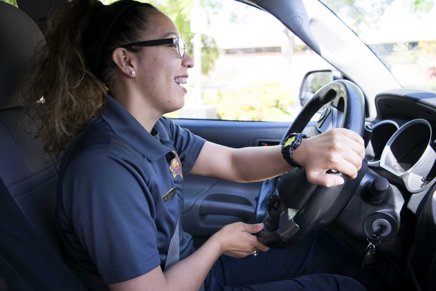 New Campus Safety Officer, Denise Zambrana, smiles and laughs as she reminisces about her time as a security officer at Pepperdine University.  Photo by Roman Valenzuela - Staff Photographer