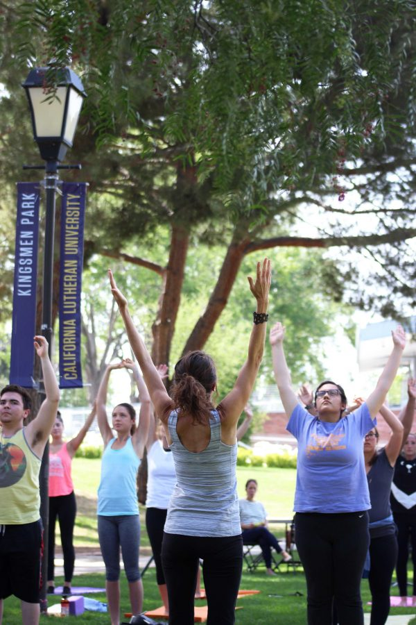 Professor Lyons' class gathers for yoga in the park, an event put on by Student Life to celebrate Green Week. Photo by Amanda Marston - Staff Photographer