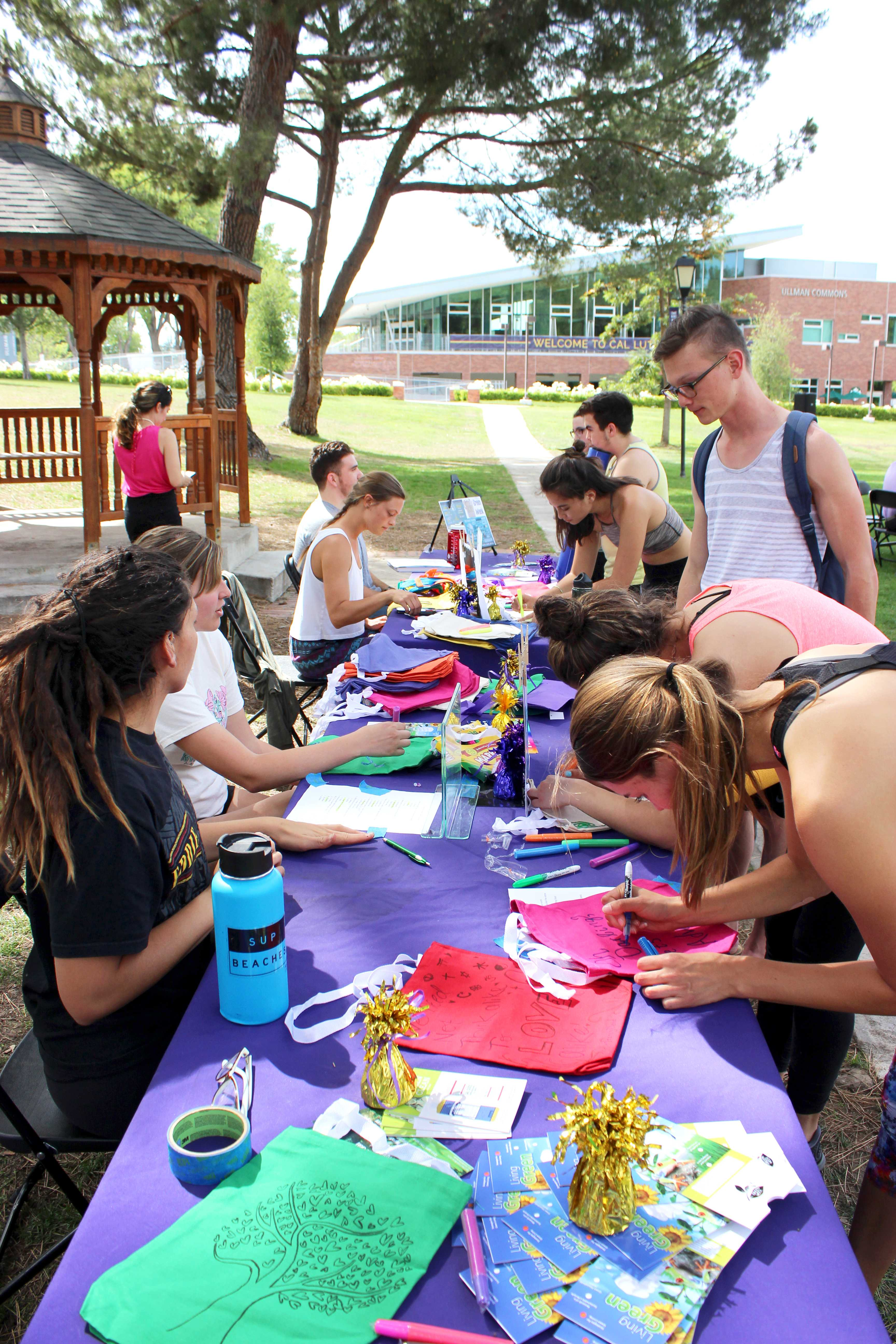 As part of Green Week on Cal Lutheran's campus, students participated by decorating their own reusable canvas bags after yoga in the park. Photo by Amanda Marston - Staff Photographer