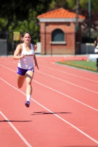 Senior team caption Amanda Hamilton running the 200-meter for Cal Lutheran. Hamilton competed in a total of 6 events at the third SCIAC meet. Photo by Madi Schmader - Staff Photographer