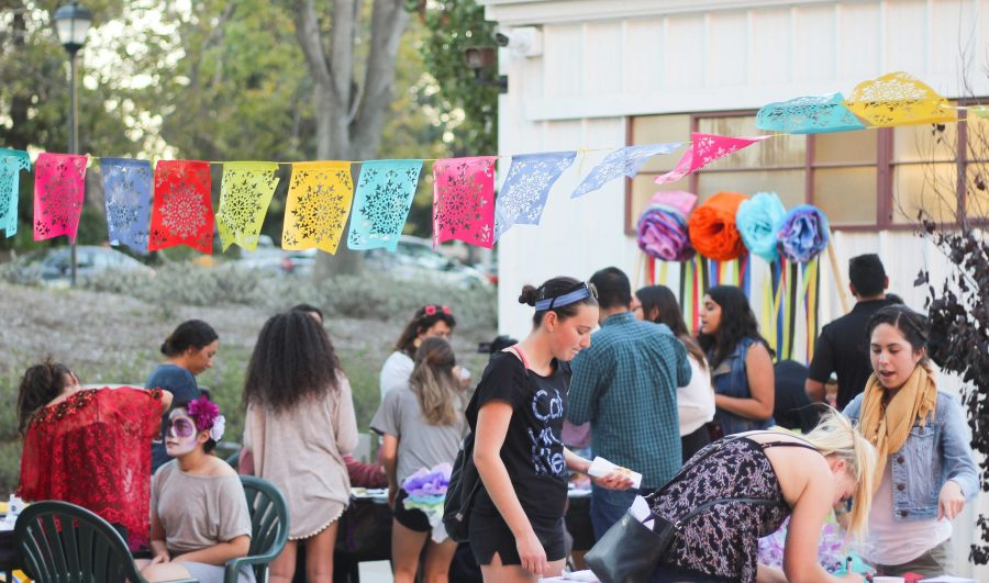 Honoring tradition: Crafts at Dia de los Muertos included face painting, sugar skull decorating, tissue paper flower making, bingo and entering in a raffle to win prizes from the Latin American Student Organization.