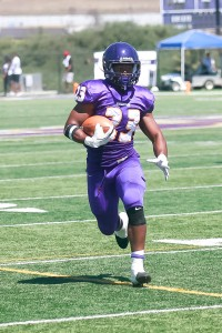 Running past: Junior running-back Foorever Campbell runs back into play this season after suffering an ACL tear in 2014.   Photo Credit--Andy Horan Sports Information Photographer
