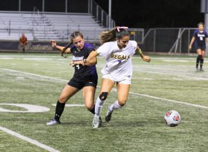 Moving past: Bri Pinal defends against Whittier by taking lead of the ball.  Photo Credit--Ashleigh Coulter Staff Photographer