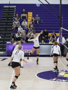 Clinched it: (L to R) #17 Michelle Lawrence #8 Jamie Smith, #4 Amanda Roberts and #3 Sarah Pappas. Roberts looks to send the ball over the net and grab a kill to further the Regals lead. Photo Credit--Morgan Mantilla Staff Photographer
