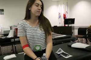 Delaney Lipp relaxes and restores her energy after donating blood for the first time.  Photo by Ashleigh Coulter - Staff Photographer