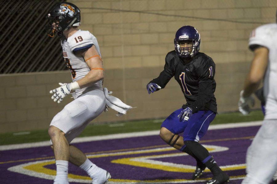Making plays: Logan Sanders defends against an Occidental player as they turn to score at Saturday's game.  Photo Credit--Ashleigh Coulter Staff Photographer